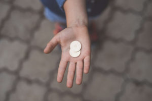 Person with coins in their hand